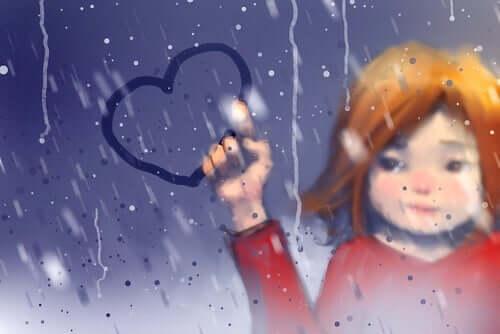 Camdaki buhara kalp çizen bir kadın resmi.